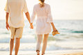 Mature Couple Walking On The Beach At Sunset Royalty Free Stock Photography - 63858717