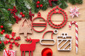 Christmas Tree Decoration With Wooden Ornaments On Wooden Background Stock Photography - 63862862