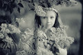 Girl In  Branches Of Lilac Stock Image - 63890051
