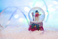 Snow Globe With Happy Snowman Blured Background Royalty Free Stock Photography - 63891687