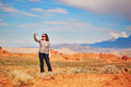 Tourist Taking Photo With Her Mobile Phone In Valley Of The Fire Royalty Free Stock Image - 63896026