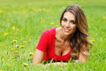 Young Woman In Red Dress Lying On Grass Royalty Free Stock Images - 63911369