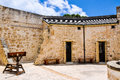 The Round House: Colonial Limestone And Stocks Royalty Free Stock Image - 63938046