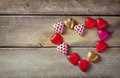 Top View Image Of Colorful Heart Shape Chocolates On Wooden Table. Valentine S Day Celebration Concept Stock Image - 63944301