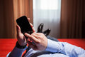 Relaxed Businessman Holding A Mobile Phone Royalty Free Stock Photography - 63964887