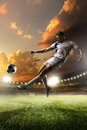 Soccer Player In Action On Sunset Stadium Background Stock Photo - 63968920
