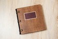 Photo Book In A Brown Wooden Cover Royalty Free Stock Photos - 63971798