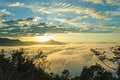 Beautiful Rising Sun In The Early Morning Over Sea Of Fog On Hill Of Phu Tok. Stock Photos - 63978523