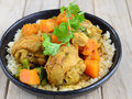 Chicken And Pumpkin Curry With Couscous Royalty Free Stock Photos - 63981698