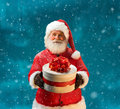 Happy And Kind Santa Claus With Christmas Present Royalty Free Stock Photos - 63988228