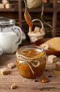 Homemade Caramel Sauce On Wooden Table Royalty Free Stock Image - 64024206