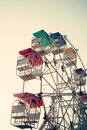 Ferris Wheel And Sky With Retro Filter Effect (vintage Style) Royalty Free Stock Photo - 64025145