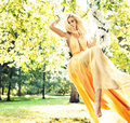 Mysterious Nymph Swinging On The Flowery Seesaw Royalty Free Stock Photos - 64049238