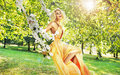 Pretty Young Woman Swinging In The Middle Of The Garden Stock Image - 64049441