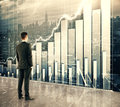 Businessman Looking At Big Screen With Business Graph Royalty Free Stock Images - 64051339