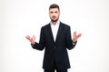 Handsome Puzzled Businessman With Beard Holding Copyspace In Both Hands Royalty Free Stock Images - 64062829