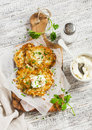 Potato Pancakes Or Latkes With Cream Served On Olive Cutting Board Over White Wooden Table. Rustic Style. Stock Images - 64125724