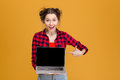 Joyful Beautiful Woman Holding And Pointing On Blank Screen Laptop Royalty Free Stock Image - 64153556