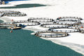 Fish Farm In Frozen Lake Stock Photography - 64156092