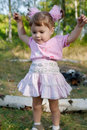 Girl With Pink Bows Trying To Jump Royalty Free Stock Images - 6425229