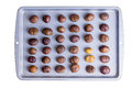 Whole Roasted Chestnuts On A Roasting Tray Stock Photography - 64237102