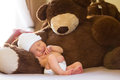 Neborn Napping With Teddy Stock Photos - 64334143