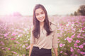 Beautiful Asian Women Smiling In Pink Cosmos Flower Field Royalty Free Stock Image - 64350796