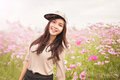 Beautiful Asian Women Smiling In Pink Cosmos Flower Field Royalty Free Stock Photography - 64350817
