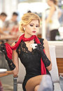 Fashionable Attractive Lady With Little Black Dress And Red Scarf Sitting On Chair In Restaurant And Drinking Coffee Stock Images - 64366154