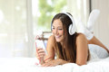 Girl Listening To Music From A Smartphone At Home Stock Photo - 64408570