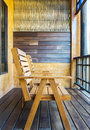 Wooden Table And Chair Set With Abstract Wall On Vintage Style Balcony By The Garden Stock Images - 64430444