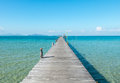 Vacation Time Concept, Wooden Path Between Crystal Clear Blue Sea And Sky From Beach Of Island To The Pier In Thailand Royalty Free Stock Photo - 64430515