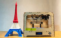 Eiffel Tower Model With Red White Blue Stripe Printed By 3D Printer With 3D Printer On Wooden Table Stock Photos - 64430783
