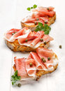 Sandwich With Grilled Country Bread With The Addition Of Smoked Ham And Capers Royalty Free Stock Photos - 64451078