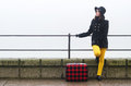 Young Girl With Suitcase Travelling Somewhere On Misty Autumn Day Stock Photography - 64457752