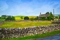 Beautiful, Old English Cottage With Stone Wall In Yorkshire, England, UK Stock Photography - 64458812