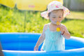 Little Baby Playing With Toys In Inflatable Pool Royalty Free Stock Photo - 64484965