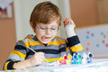 Little Kid Boy Drawing With Colorful Watercolors Royalty Free Stock Photo - 64513275