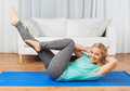 Woman Exercising On Mat At Home Stock Image - 64515711