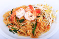 Fried Noodle Thai Style With Prawns, Stir Fry Noodles With Shrimp In Padthai Style On Table. Front View Isolate White , Brown   Ba Royalty Free Stock Images - 64560819