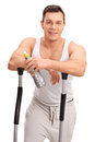 Man Leaning On The Handles Of A Cross Trainer Royalty Free Stock Photos - 64568768