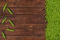 Green Peas On Old Wooden Table Top View Royalty Free Stock Photo - 64572935