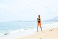 Sports. Athlete Jogging On Beach. Fitness, Exercising, Healthy L Stock Photo - 64578090