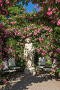Roses And Gods Statue In The Rose Garden Beutig In Baden-Baden Royalty Free Stock Images - 64581659