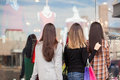 Women Standing In Front Of A Clothing Store Royalty Free Stock Images - 64606339