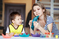 Curious Childhood, A Little Boy Playing With His Mother, Draws, Paints On The Palms. Royalty Free Stock Images - 64619379