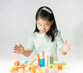 Little Asian Girl Playing Colorful Wood Blocks Stock Image - 64633651