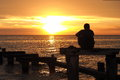 Lonely Man Watching The Sunset At Port Philip Bay Royalty Free Stock Photo - 64659425