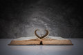 Pages Of A Book Forming The Shape Of The Heart. Stock Photo - 64662040