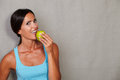 Smiling Woman Holding And Eating Apple Royalty Free Stock Photos - 64675928
